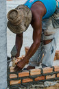 Bricklayer in site builder laying bricks Royalty Free Stock Photography