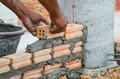 Bricklayer in site builder laying bricks Stock Images