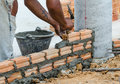 Bricklayer in site builder laying bricks Stock Photos