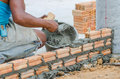 Bricklayer in site builder laying bricks Stock Photography