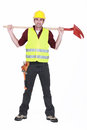 Bricklayer standing legs apart full body portrait of carrying shovel on his shoulders Stock Photos