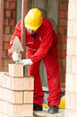 Bricklayer at work with red brick Royalty Free Stock Photo