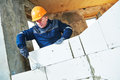 Bricklayer at work with silicate brick Royalty Free Stock Photo