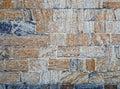 Bricks of concrete blocks textured orange and blue gray stones wall pattern