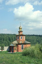 Bricks orthodox chapel with dome amidst summer meadow Royalty Free Stock Photo