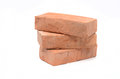 Bricks pile of isolated on white Royalty Free Stock Photography