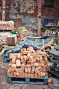 Bricks in scrap yard pile of old a Stock Image