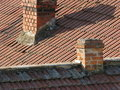 Bricks and tiles intersections of roof chimneys Royalty Free Stock Photography