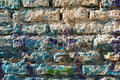 Bricks wall painted in different paint pastel colours background for invitation Royalty Free Stock Images
