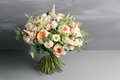 Bridal beautiful bouquet made of different flowers on grey background. colorful color mix flower. close-up Royalty Free Stock Photo