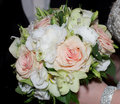 Bridal bouquet beautiful with flowers and pearls in bride hands Royalty Free Stock Image