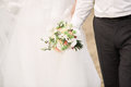 Bridal bouquet. Bride and groom holding hands. Royalty Free Stock Photo