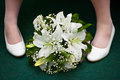 Bridal bouquet and bride's feet Stock Photo