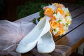 Bridal bouquet and bride s shoes wedding still life Stock Photos