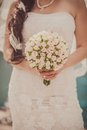 Bridal bouquet of flowers in hands the bride Royalty Free Stock Image