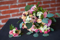 Bridal bouquet of fresh flowers and grooms boutonniere o Royalty Free Stock Photo