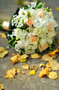 Bridal bouquet golden wedding rings outside sunny autumn day Stock Photos
