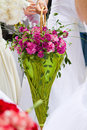 Bridal bouquet nonstandard among white dresses Royalty Free Stock Photography