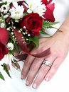 Bridal bouquet and ringed hand Royalty Free Stock Photography
