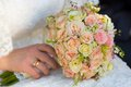 Bridal bouquet of roses rose flowers in hand Royalty Free Stock Photos