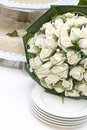 Bridal bouquet and wedding cake Royalty Free Stock Photos