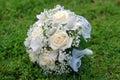 Bridal bouquet of white roses and irises Stock Photo