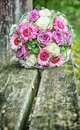 Bridal bouquet on a wooden bench Stock Photo