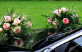 Bridal bouquets mirroring in glossy black car Royalty Free Stock Photography