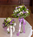 Bridal bouquets in vases two on the table Royalty Free Stock Image