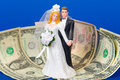 Bridal couple on money in front of Stock Image