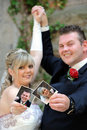 Bridal couple showing photos from her self Stock Images