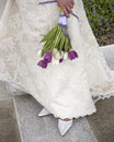 Bridal gown, shoes and bouquet Stock Image