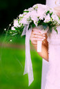 Bridal hand with wedding bouquet Royalty Free Stock Images