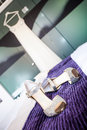 Bridal outfit image of the brides bling shoes on the purple blanket with her wedding dress in the background Stock Images