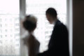 Bridal pair looking out the window bride and groom of focus washed silhouettes romantic moments Royalty Free Stock Photo