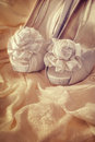 Bridal sandals against a wedding dress Royalty Free Stock Images