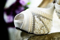 Bridal shoe detail the beautiful rose with wedding and beads Royalty Free Stock Photo