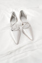Bridal shoes on the bed with white background Royalty Free Stock Image