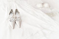 Bridal shoes on the bed with white background Stock Photos