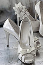 Bridal shoes decorated with flowers wedding dress on background Stock Images