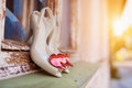 Bridal shoes on window parapet with red hearts laid Royalty Free Stock Photos