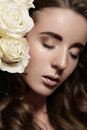 Bridal style with roses luxury wedding make up beauty closeup of pretty woman natural fashion makeup glossy lips strong eyebrows Royalty Free Stock Photography