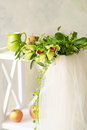 Bridal veil and beautiful orchid wreath still life with lying down of a white wooden stand Stock Photography