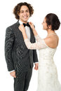 Bride adjusting her man s bow tie attractive young the of Stock Images