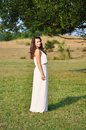 Bride in a beautiful natural landscape Stock Photo
