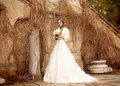 Bride beautiful woman in wedding dress - outdoor Royalty Free Stock Photo