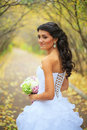 Bride beautiful young on beautiful outdoor grounds Royalty Free Stock Photo