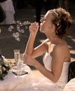 Bride blowing bubbles Royalty Free Stock Photo