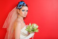 Bride with blue makeup and mask in hairdo Stock Photography