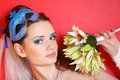 Bride with blue makeup and mask in hairdo holds bo Royalty Free Stock Photography